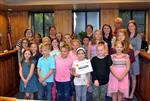 Students in Grapevine Garden Growers post with teachers and a board member after receiving certificate.